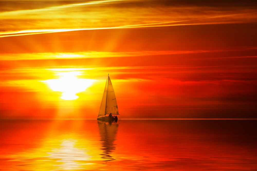 sailboat red yellow sunset